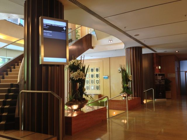 Alt text: audiovisual equipment integrated into hotel meeting space